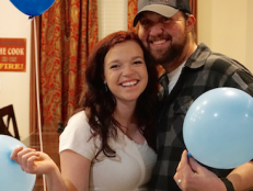 The couple revealed the happy news to their family with an adorable gender reveal party.